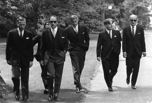 Prime Minister Pierre Trudeau (second from left) wearing dark glasses, arrives with members of his new cabinet for swearing in ceremonies at Government House in Ottawa, July 6, 1968. Saturday. Left to right are: James Richardson, minister without portfolio, D.C. Jamieson, (partly hidden), minister without portfolio, Trudeau, Justice Minister John Turner, Jean Marchand, Forestry Minister, and Gerard Pelletier, State Secretary. Ten years after his death, and more than four decades after it was taken, the photo of Pierre Trudeau striding up the drive at Rideau Hall - flanked by his dark-suited cabinet-to-be - still packs a blast of movie-star, hipster cool. THE CANADIAN PRESS/Doug Ball